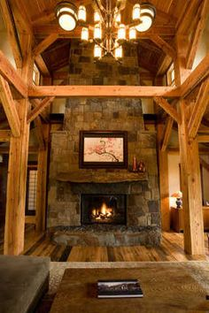 Love the open the space. Wood beams and huge stone fireplace, beautiful!