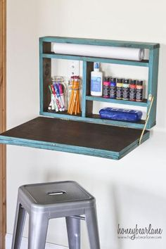 Setting up a study spot is essential, and how clever is this little DIY fold down desk? It's a total space saver too, and, when folded up, becomes a chalkboard. Its no wonder this and other smart workspaces have been re-pinned like mad. (Credit: Honey Bear Lane)