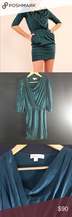 """Amour Vert Luxurious 100% Silk Faux Wrap Dress M Amour Vert Paris Women's LuxuriousSueded Silk Faux Wrap Dress MSRP: $189 Material: 100% Silk Neckline Swoop 2 pockets on either side of dress 3.5"""" X 4"""" Bottom right side gathers see pictures Size M Measurements: Neckline drop 4"""" Bust 31"""" Waist 24"""" has elastic see pictures Hips 32"""" Shoulder to hem 36""""  Buy with confidence. Thank you for shopping with me! Amour Vert Dresses Mini"""