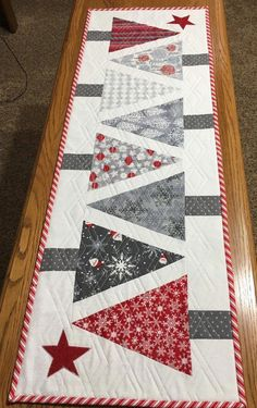 Table runners Create a festive holiday table with this charming table runner. This handmade runner f Quilted Table Runners Christmas, Christmas Tree On Table, Table Runner And Placemats, Patchwork Table Runner, Christmas Runner, Christmas Quilting, Quilted Table Runner Patterns, Quilt Table Runners, Christmas Tree Quilt Pattern