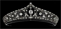 One of the most popular tiara designs from the late eighteenth century is the  kokoshnik, a derivative of the headdress of Russian peasant women.  This example is made from platinum and set with brilliant cut diamonds.  It dates from 1911 and bears the signature of Andre Falize, Paris.