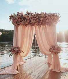 Wedding along the water - pink wedding ceremony with roses