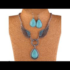 """Turquoise angel wing necklace and earring set Silver tone angel wing pendant necklace and earring set. The necklace is around 18"""" Jewelry Necklaces"""
