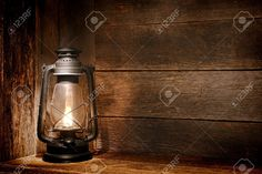 Picture of Old fashioned vintage kerosene oil lantern lamp burning with a soft glow light in an antique rustic country barn with aged wood wall and weathered wooden floor stock photo, images and stock photography. Lantern Lamp, Lanterns, Home Studio Photography, Let Your Light Shine, Aging Wood, Mason Jar Lamp, Original Image, Light In The Dark, Vintage Fashion