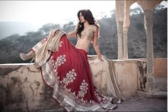 Anita Dongre maroon and gold lengha