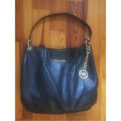 Michael Kors Leather Bag Authentic, gently used black leather purse. The leather is in great condition, only slight wear on bronze hardware. MICHAEL Michael Kors Bags