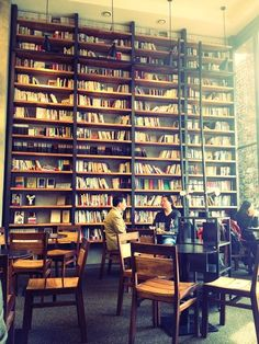 WN- take a combination of magazines, books and papers to your table, pick out words that leap out- do your poem Cafe Design, House Design, Library Cafe, My Coffee Shop, Cute Cafe, Book Cafe, Wall Bookshelves, High Walls, Cafe Interior