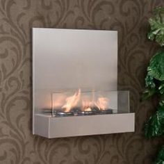 How awesome is this?! @Overstock - This portable gel fuel fireplace features a stainless steel finish and glass accents. This fireplace also hangs easily like a picture.http://www.overstock.com/Home-Garden/Tate-Stainless-Steel-Glass-Wall-mount-Fireplace/5472608/product.html?CID=214117 $152.99