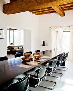 long wood table. different chairs. maybe divide the table in two to make it easy to move out on the deck for evening dinners. But able to have it as one long table in the living room.