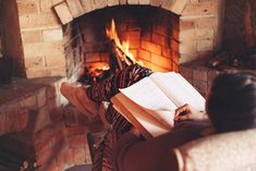 Cozy log cabin fire - reading a book in pyjamas. Rustic living room ideas.