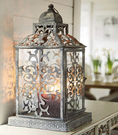 Bathroom Decorating Ideas, Romantic Gray-Purple Color Combination, Gray Lantern with purple candle- can spray paint birdfeedee deco from wedding to look like this Lanterns Decor, Candle Lanterns, Decoration Chic, Lampe Decoration, Purple Color Combinations, Purple Candles, Purple Bathrooms, Bathroom Colors, Chandeliers