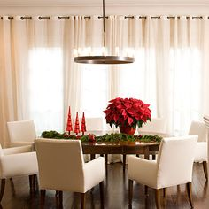 Drape the Dining Room - 79 Stylish Dining Room Ideas - Southernliving. Use draperies to bring texture to your dining room. Curtain panels transverse an entire wall in this dining room. The sheer fabric still allows natural light to filter into the space. Small Dining, Dining Area, Christmas Table Centerpieces, Centerpiece Ideas, Holiday Decorations, Country Dining Rooms, Simple Christmas, Christmas Decor, Christmas Time