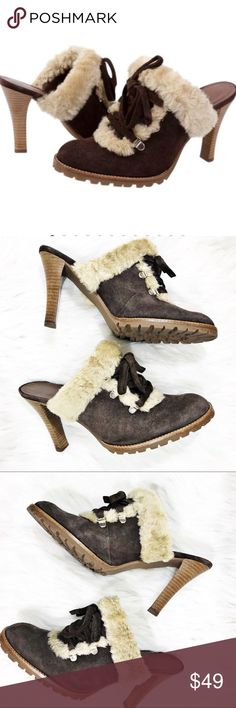 Gianni Bini Stowe Brown Suede Fur Mules Clogs Heel Gianni Bini Stowe Brown Suede Fur Mules Clogs. Slip on backless Heels by Gianni Bini in Brown Suede., The Stowe Mules with Faux Shearling Trim. Silver Hardware on the faux Tie Front . Rugged tread Bottoms . Stacked Wood Heel approx 4 inches . Suede Leather Uppers. Man made lining and trim . So cute love these . Preloved in wonderful condition. Size 7.5 Gianni Bini Stowe Brown Suede Mules Clogs Backless Heels . Gianni Bini Shoes Mules & Clogs