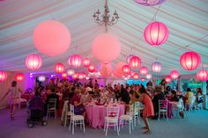 The ultimate girly girl wedding using shades of pink and purple paper lanterns in a mix of sizes really bring this marquee to life and with a look that's right on trend!