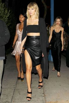In Christian Louboutin shoes while arriving at Drake's birthday party in Los Angeles.