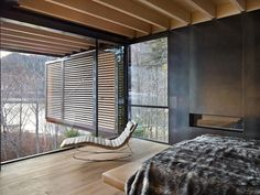 Image 16 of 36 from gallery of Whistler Ski House / Olson Kundig. Photograph by Benjamin Benschneider Concrete Fireplace, Fireplace Hearth, Whistler, Ski Rental, Glazed Walls, Dining Table Design, Building A House, Skiing, Architecture Design