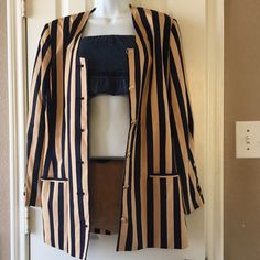 """Vintage gold & navy blue blazer Revised, size medium, 10.  Vintage striped navy blue and gold long blazer.  Missing button on the top.  Has gold button details in arm cuffs.  Measurements, under arm to under arm 18"""". Vintage Jackets & Coats Blazers"""