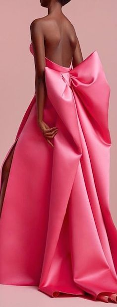 Pink satin dress with large bow