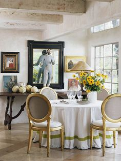 love the whitewashed beams, gold leafed chairs with contrasting seat and back, and the table cloth
