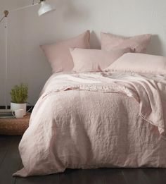 The perfect place for spending Sunday mornings. We love this relaxed linen bedroom style. Discover our Secret Linen Store. Blush Pink Bedroom, Pink Bedding Set, Pink Bedroom Decor, Pink Bedrooms, Linen Bedroom, Bedding Sets, Linen Duvet, Blush Pink Comforter, Cotton Bedding