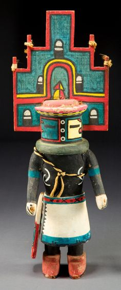 SOUTHWESTERN: HOPI Cottonwood Kachina Doll, c. 1950. Among the Hopi, kachina dolls are traditionally carved by the uncles and given to uninitiated girls at the Bean Dance (Spring Bean Planting Ceremony) and Home Dance Ceremony in the summer. The function of the dolls is to acquaint children with some of the many kachinas.