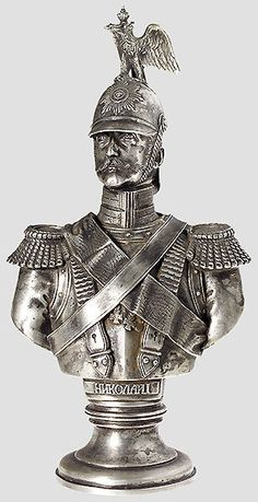 """A silver bust ofFriedrich A.T. DietrichThe Czar is portrayed in the uniform of the Chevalier Guards, with a Cyrillic inscription """"Nikolai I"""" under the breastplate. The round, tiered pedestal has the jeweler's hallmark """"Morosov"""", the eagle, the 1894 St. Petersburg inspection mark for silver content """"84"""", and inspector's mark """"A. Sch."""""""