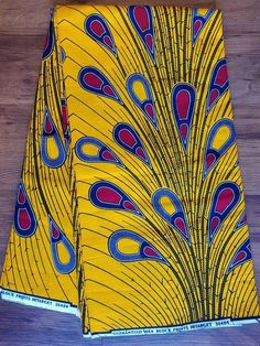 DESCRIPTION Yellow And Red Multicolor Ankara Fabric. This is high quality African print is 100% cotton and its 45 inches wide. It is used for making African Clothing, African quilts, & For Home decoration. The listing is for 1 yard, 6 yards and Headwrap Each piece of fabric