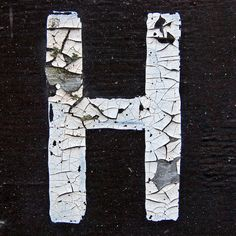H out of white and black peely paint