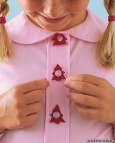 Kids can spruce up their clothes with festive no-sew button covers by cutting felt into tree shapes.