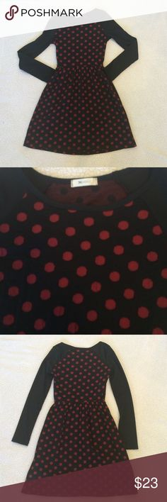 """❌SOLD❌Black and Red Polka Dot Dress This is a darling dress for fall and winter! It has a black background and sleeves with red polkadots on the front and back.  In great pre-loved condition with no major signs of wear. Hand washable, too!  15"""" armpit to armpit, 11"""" across unstretched elastic waist (can stretch to 14""""), 35"""" shoulder to hem. Everly Dresses"""