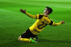 Christian Pulisic of Borussia Dortmund celebrates after he shoots and scores his teams second goal during the UEFA Champions League Round of 16 second leg match between Borussia Dortmund and SL. Get premium, high resolution news photos at Getty Images Soccer Baby, Us Soccer, Football Players, Bvb Wallpaper, Dynamo Dresden, Signal Iduna, Christian Pulisic, Association Football, Marco Reus
