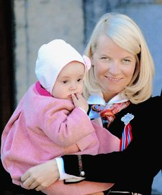 Little Princess Ingrid Alexandra with her mother Crown Princess Mette-Marit watches the annual Norwegian National Day parade from the balcony of The Royal Palace in Oslo in 2004.