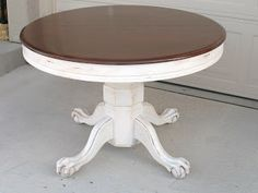 Oak clawfoot table redo with walnut stain and white distressing.