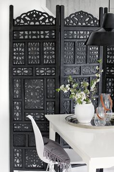 STYLIZIMO BLOG - I love this morrocan wall. I would love this panel wall in my living room