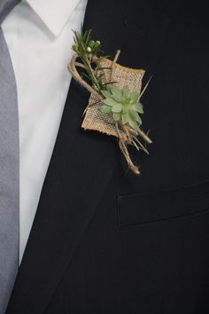 Burlap/Succulent boutonniere created by Judith Marie at Fox Bros Floral, Hartland, WI