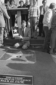 Leonard Nimoy proudly holds his star on the Hollywood Walk of Fame He was honored on January 16 1985