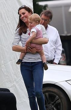 Catherine went casual at the charity match in blue jeans and flats with a blue and white