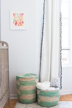 Gender neutral baby nursery featuring The Land of Nod's Aqua Herringbone Hamper and Floor Bin.