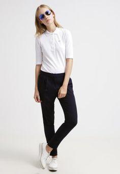 Der Klassiker überzeugt bis heute! Lacoste Poloshirt - blanc für 89,95 € (11.11.15) versandkostenfrei bei Zalando bestellen.