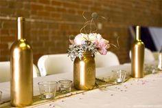 DIY gold wine bottles/mason jars, blush peonies and dusty miller and gold accents complete floral centerpieces. Wedding Centerpieces Mason Jars, Wedding Wine Bottles, Floral Centerpieces, Gold Mason Jars, Mason Jar Wine, Gold Bottles, Purple Table Decorations, Diy Wedding Decorations, Spray Painted Bottles