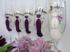 WHAT A CUTE KEEPSAKE FOR THE BRIDAL PARTY TO REMEMBER YOUR SPECIAL DAY!! These beautiful and unique hand painted bridal party wine glasses will be PERSONALIZED TO YOUR EXACT DRESSES that you will be wearing in YOUR wedding, including color, style and any detail or embellishments throughout the dress, flowers, titles, names and dates. They make the perfect thank you gift to the bridesmaids/groomsmen who took part in your special day - Or give them to your bridal party as an invite to be in…
