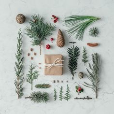 Creative natural layout made of winter things with christmas present on marble background. by zamurovic. Creative natural layout made of winter things with christmas present on marble background. Christmas Presents, Christmas Time, Christmas Layout, Winter Christmas, Xmas, Holiday Gift Guide, Holiday Gifts, Meredith Andrews, Christmas Flatlay