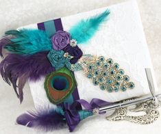 Wedding Guest Book and Pen Set in Peacock, Purple, Teal and Ivory with Crystal Jewels, Feathers and Lace. $140.00, via Etsy.