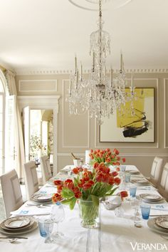 In Rollins's dining room, a generous crystal chandelier overlooks Christian Dior glasses, Mottahedeh chargers and dinners plate, and salad plates from Tiffany & Co. The art is by Hyunmee Lee from Bill Lowe Gallery. More on Veranda.com:Here's How You REALLY Fly First Class: The VIP Boeing 747-8   - Veranda.com