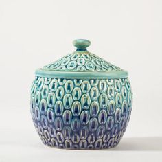 Peacock Canister- the perfect way to add color to your bathroom