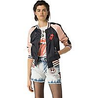 Tommy Hilfiger women's jacket. Styled from colorblocked satin, this iconic jacket features a traditional varsity silhouette punctuated by a custom graphic at the chest. From the Rolling Stones collection, our rock 'n' roll capsule inspired by the legendary band. • Cropped fit.• 100% synthetic. • Limited edition piece, zip closure, ribbed trim. • Machine washable.• Imported.