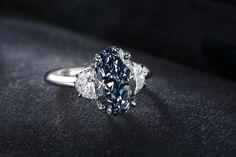 Bluish Greyish Oval Diamond Ring