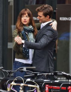 """Zac Efron goofs around with the guys, plus more stars having fun on set-Jamie Dornan took Dakota Johnson for a whirl during a break from shooting """"Fifty Shades of Grey"""" in Vancouver."""