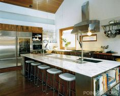 book case on the end and mixed with natural wood-21 White Kitchens To Inspire Your Next Remodel
