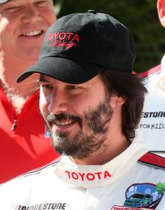 Keanu Reeves Photos Photos - Actor Keanu Reeves attends the celebrity race at the Toyota Grand Prix of Long Beach on April 18, 2009 in Long Beach, California.  (Photo by Frederick M. Brown/Getty Images) * Local Caption * Keanu Reeves - Toyota Grand Prix Of Long Beach - Day 2